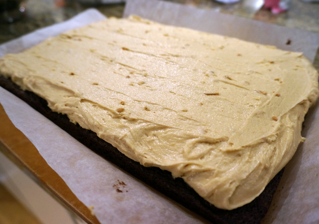 The brownie slicked over with peanut butter frosting